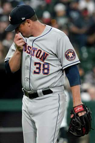 Houston Astros relief pitcher Joe Smith wipes his face as he walks to the dugout after the sixth inning of the team's baseball game against the Chicago White Sox in Chicago, Saturday, July 17, 2021. (AP Photo/Nam Y. Huh) Photo: Nam Y. Huh, Associated Press / Copyright 2021 The Associated Press. All rights reserved.