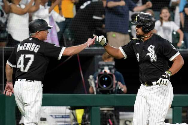 Chicago White Sox's Jose Abreu, right, celebrates with third base coach Joe McEwing after hitting a three-run home run during the sixth inning of the team's baseball game against the Houston Astros in Chicago, Saturday, July 17, 2021. (AP Photo/Nam Y. Huh) Photo: Nam Y. Huh, Associated Press / Copyright 2021 The Associated Press. All rights reserved.