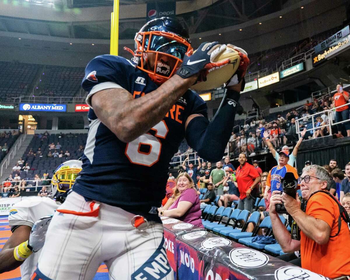 Albany Empire receiver Darius Prince scores a touchdown in front of Jersey Flight defender Rashard Smith on July 17, 2021. Prince says the team is confident heading into a matchup at Columbus.