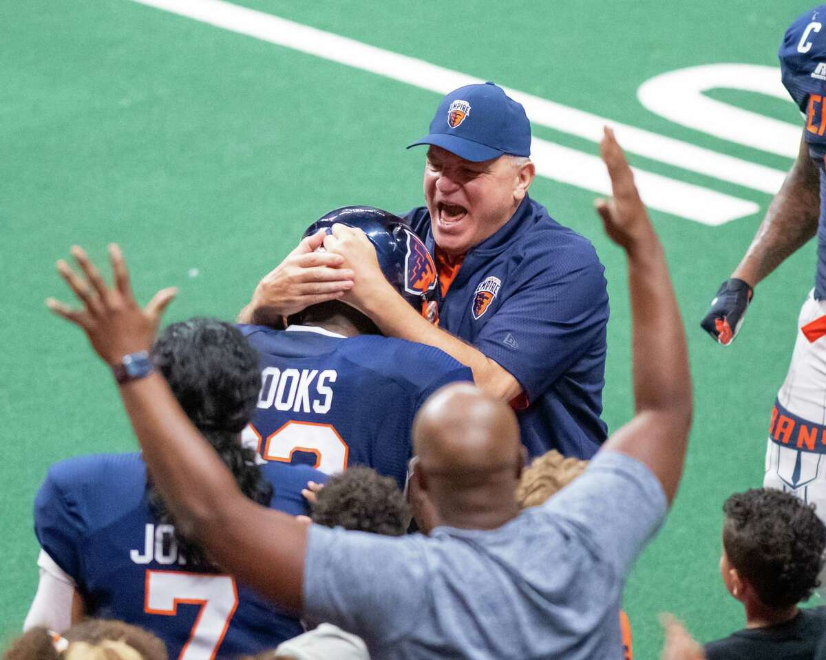 """Albany Empire Head Coach Tom Menas congratulates Charles """"CC"""" Brooks after the defensive lineman returned a fumble for a touchdown during a National Arena League game against the Jersey Flight at Times Union Center on July 17, 2021. It's one of two touchdowns he's scored this season. (Jim Franco/Special to the Times Union)"""