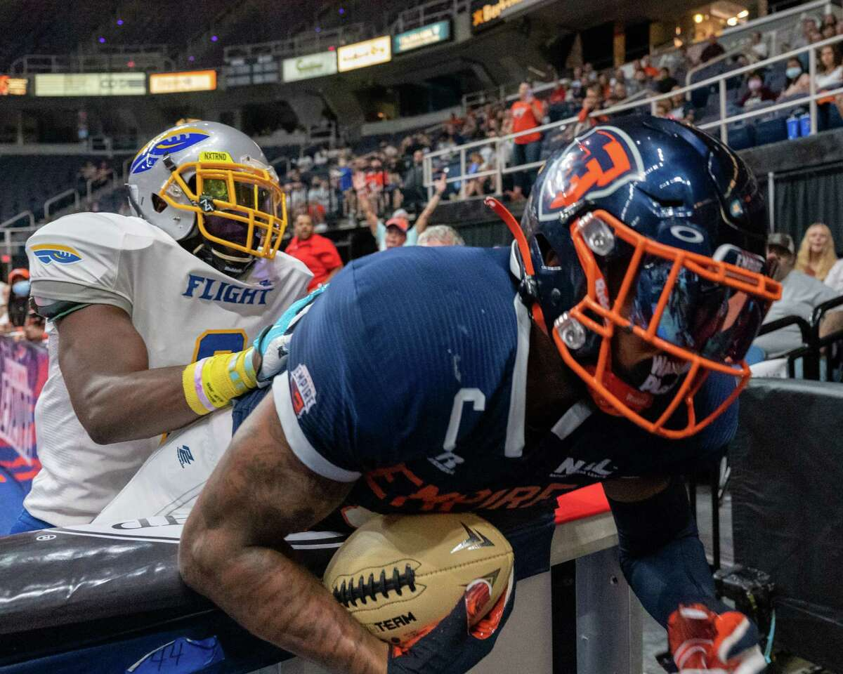Albany Empire receiver Darius Prince is pushed over the wall by Jersey Flight defender Rashard Smith after scoring a touchdown during a National Arena League game against the Jersey Flight at the Times Union Center, in Albany, NY, on Saturday, July 17, 2021. Prince says the team is confident heading into a matchup at Columbus.