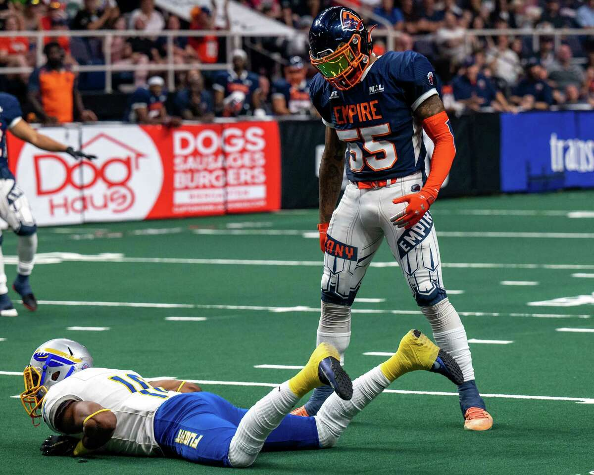 Albany Empire linebacker Trevon Shorts stares at a downed Jersey Flight receiver, Jared Dangerfield, during a game on July 17, 2021. Now Shorts is out for the season with torn thumb ligaments.
