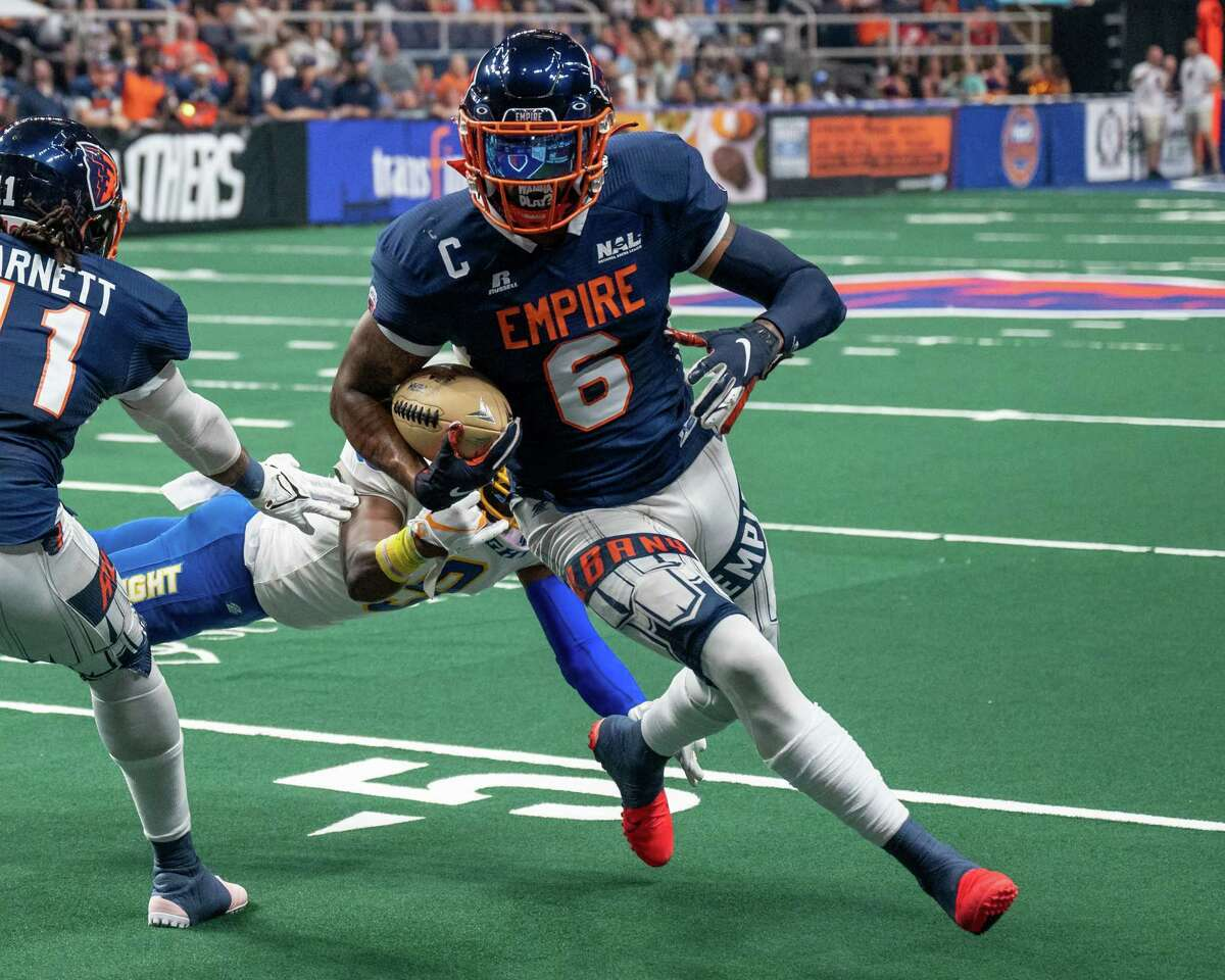 Albany Empire receiver Darius Prince scores a touchdown in front of Jersey Flight defender Rashard Smith during a National Arena League game against the Jersey Flight at the Times Union Center, in Albany, N.Y., on Saturday, July 17, 2021. Prince was named the NAL's Offensive Player of the Year.