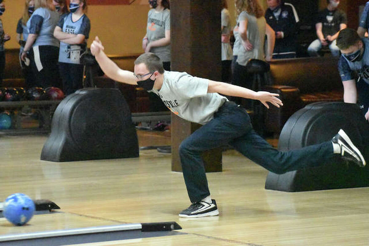 Edwardsville's Jackson Budwell rolls a strike during the third game against Belleville East on Feb. 23.