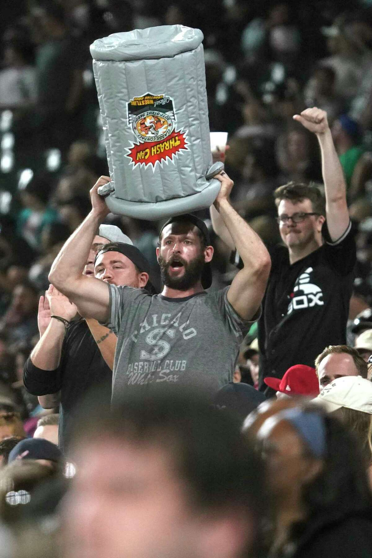 Fans watch during the ninth inning of a baseball game between the Houston Astros and the Chicago White Sox in Chicago, Saturday, July 17, 2021. The Chicago White Sox won 10-1. (AP Photo/Nam Y. Huh)