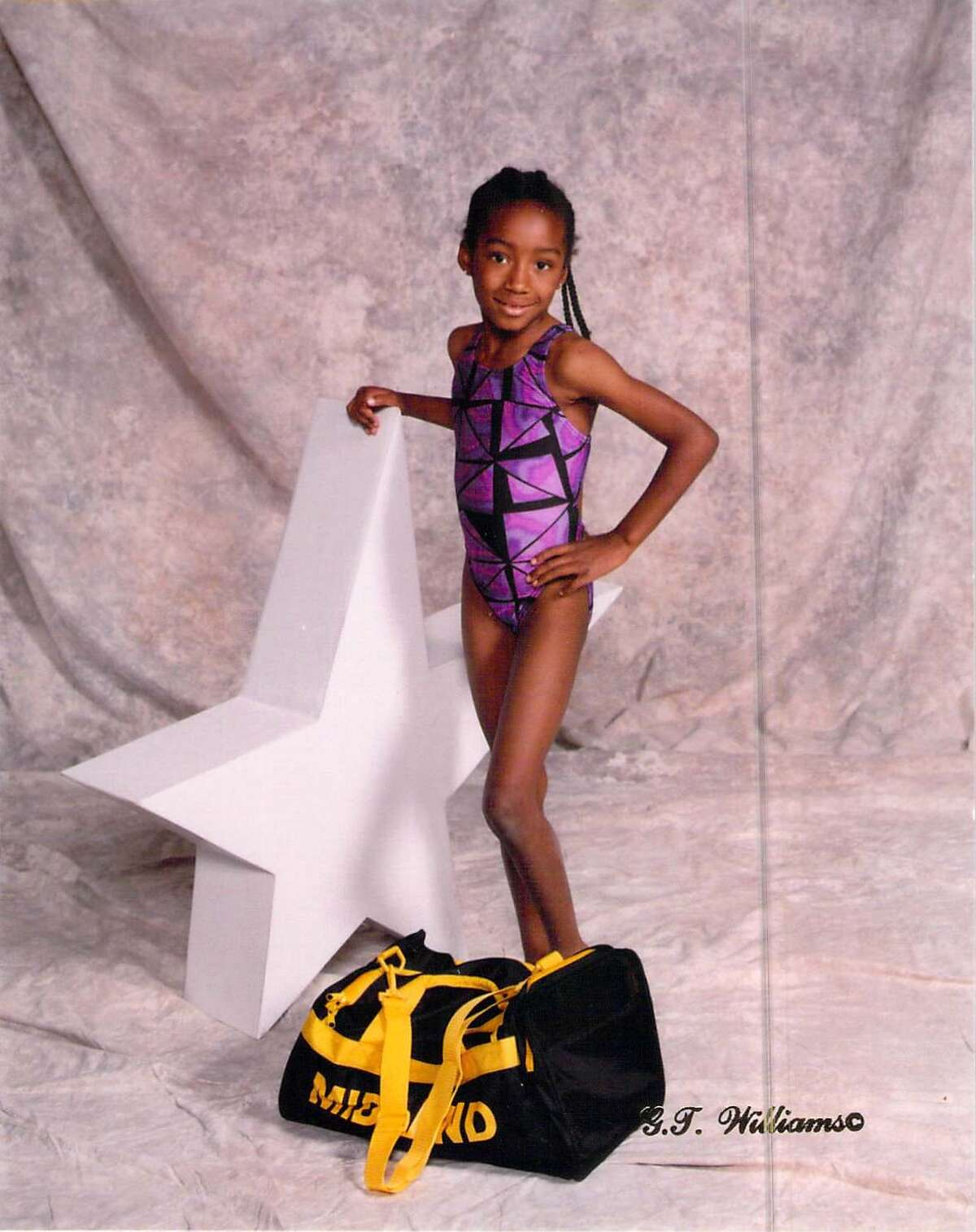 Olympic swimmer Natalie Hinds pictured when she was a young girl with COM Aquatics.