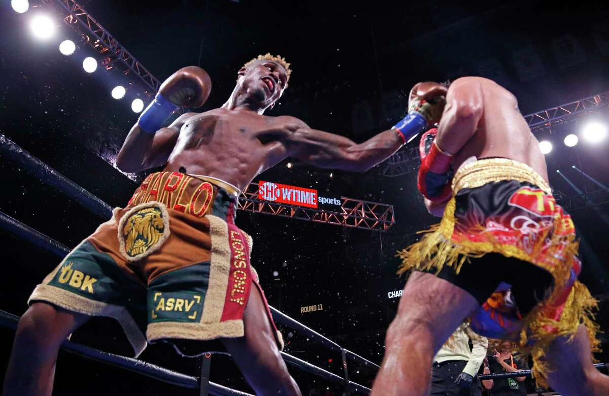 Houston's Jermell Charlo, left, connects on a left to Brian Castano. The fight ended in a draw.