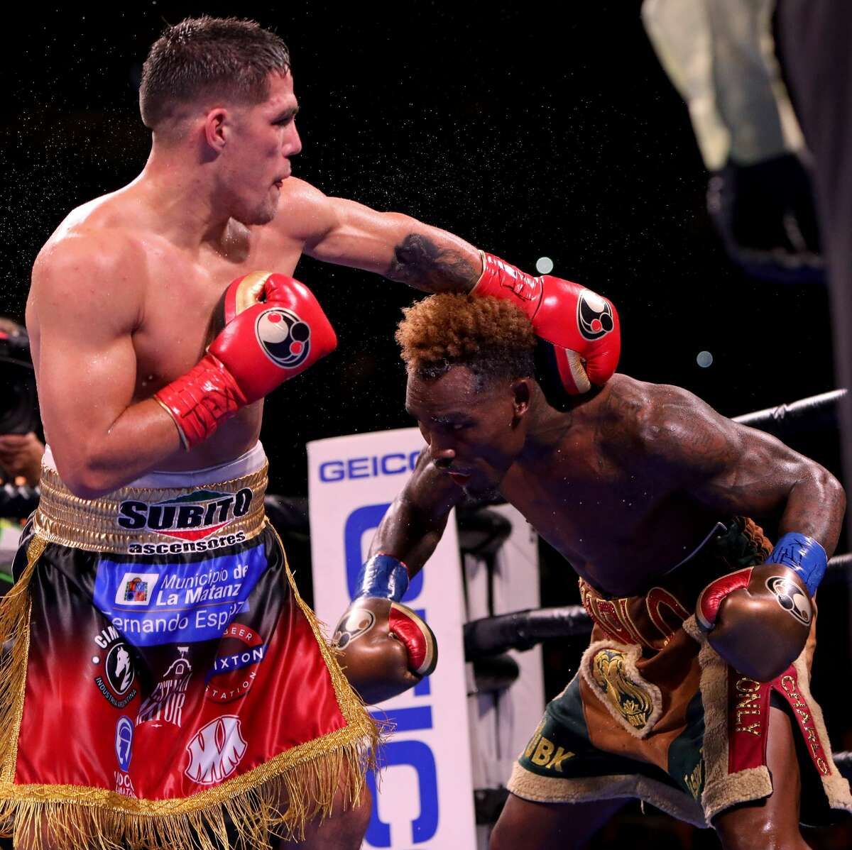 SAN ANTONIO, TX - JULY 17: Jermell Charlo (R) and Brian Castano (L) exchange punches during their Super Welterweight fight at AT&T Center on July 17, 2021 in San Antonio, Texas. The Jermell Charlo and Brian Castano fight ended in a split draw. (Photo by Edward A. Ornelas/Getty Images)