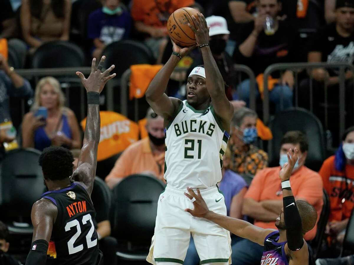 The Bucks' Jrue Holiday had 27 points, 13 assists and a key defensive play late.
