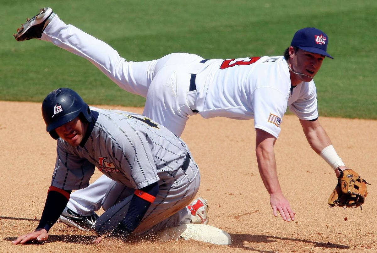 USA's Jayson Nix look to first on a double play getting Japan's Takahiko Sato and Tsuyoshi Nishioka out during the bronze medal game at the 2008 Beijing Olympics Saturday Aug 23, 2008 in Beijing, China. (PHOTO BY EDWARD A. ORNELAS/eornelas@express-news.net)