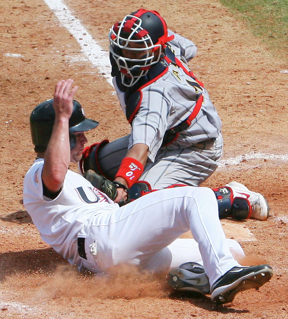 USA's Jayson Nix is tagged out as he slides into home by Japan's Shinnosuke Abe during the bronze medal game at the 2008 Beijing Olympics Saturday Aug 23, 2008 in Beijing, China. The USA won 8-4 to win the bronze medal. (PHOTO BY EDWARD A. ORNELAS/eornelas@express-news.net)