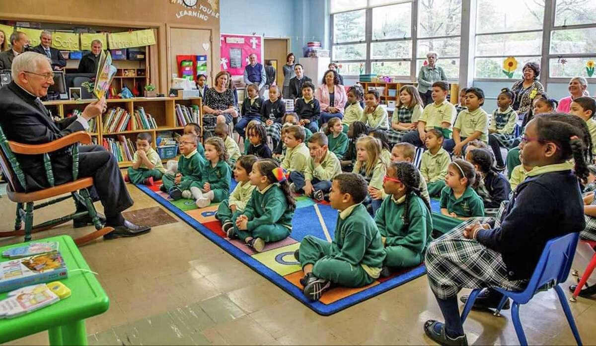 FILE PHOTO: Archbishop Leonard P. Blair reads to St. Brigid-St. Augustine Partnership School's pre-kindergarten class.