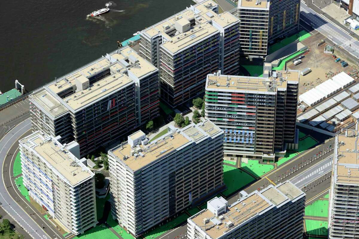 This aerial photo shows the Olympic Village in Tokyo, Sunday, July 18, 2021. Two athletes living in the Olympic Village have tested positive for COVID-19, the first to do so with the Tokyo Games opening on Friday. (Kyodo News via AP)