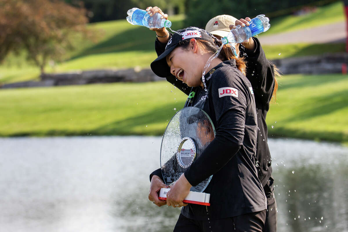 LPGA player Ariya Jutanugarn gets doused with water in celebration of her victory in the Dow Great Lakes Bay Invitational Saturday, July 17, 2021 at the Midland Country Club. (Drew Travis/for the Daily News)