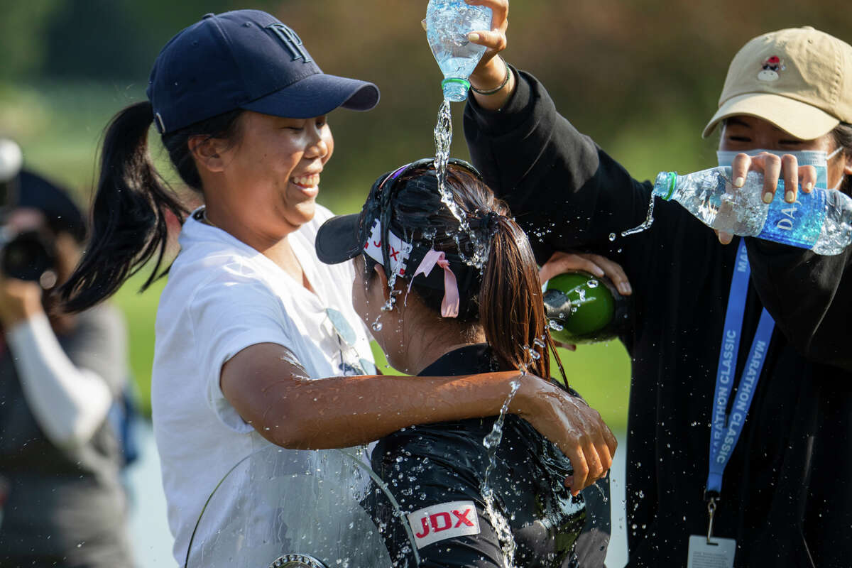 LPGA player Moriya Jutanugarn gets doused with water in celebration of her victory in the Dow Great Lakes Bay Invitational Saturday, July 17, 2021 at the Midland Country Club. (Drew Travis/for the Daily News)