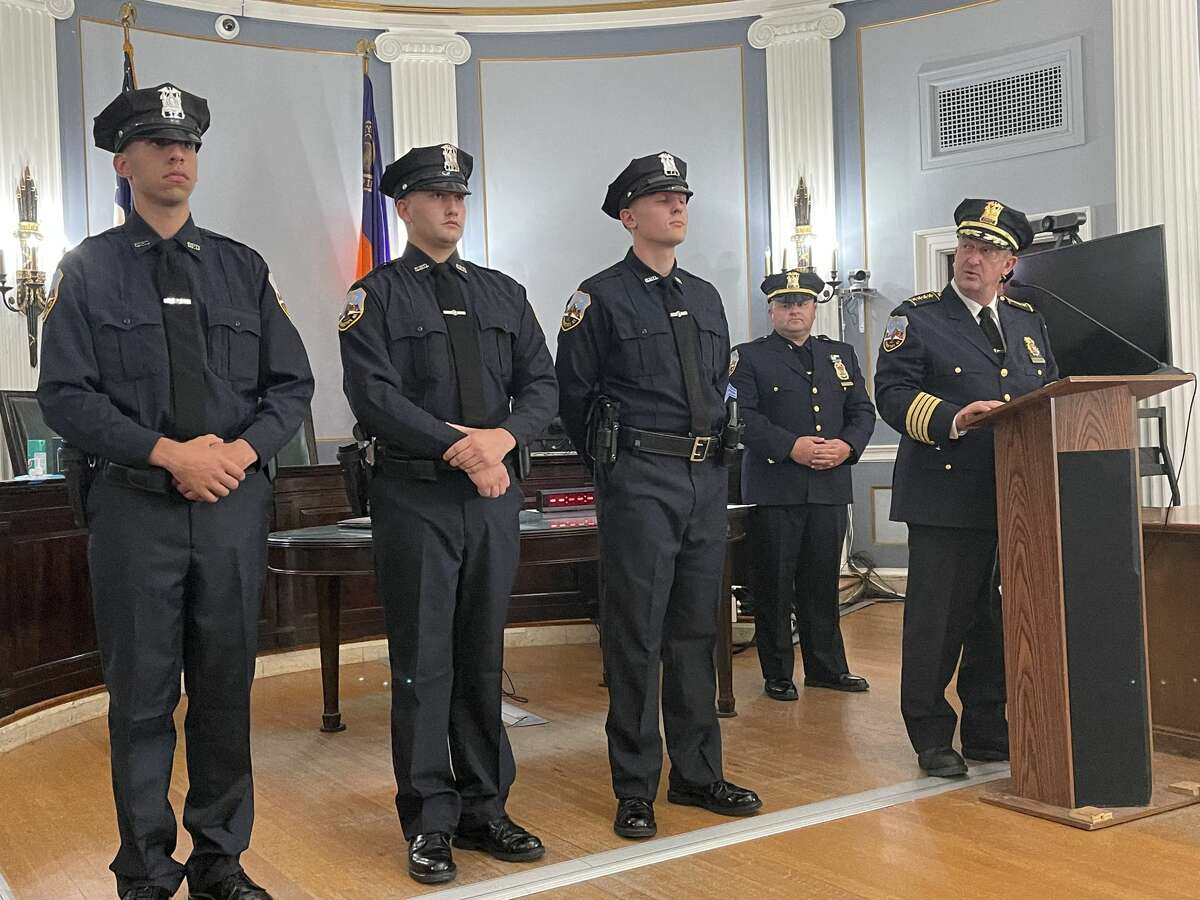 Patrolmen Ronaldo McFarlane, Joshua Clifford and Nolan Carroll wait to receive their badges and service weapons at City Hall on Wednesday, July 7, 2021 as Sgt. Matt Dearing and Chief Eric Clifford look on.