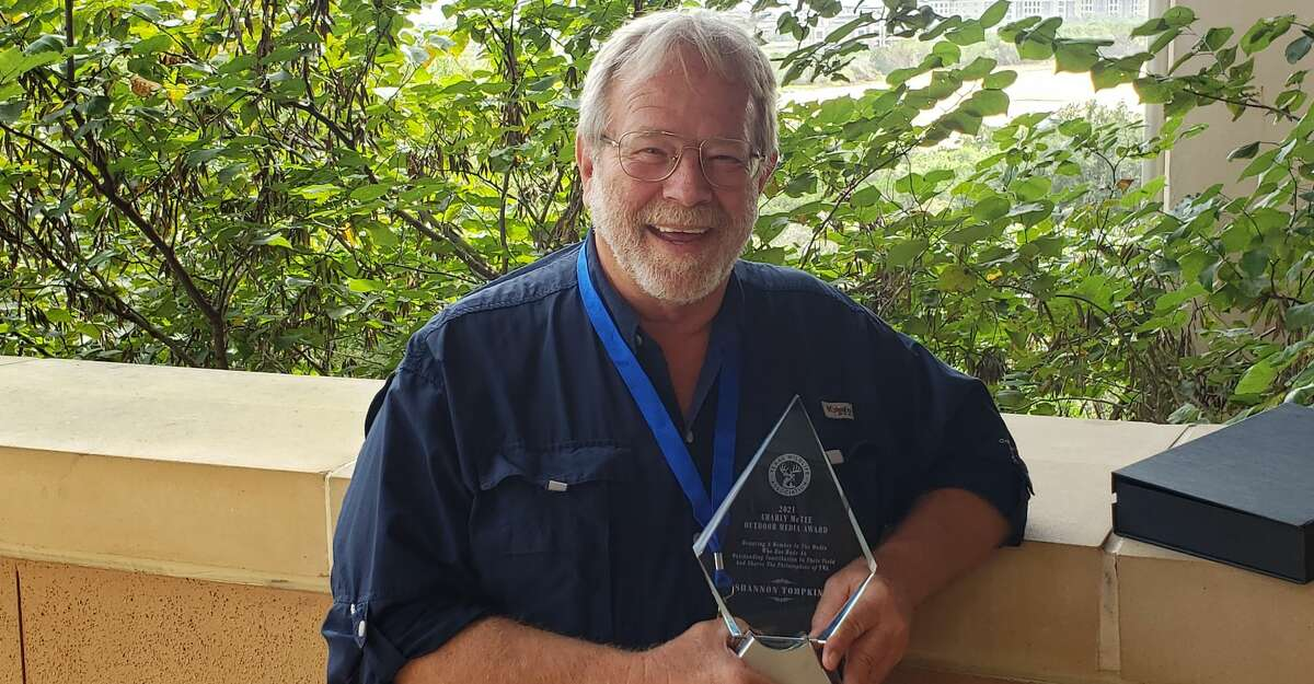 Shannon Tompkins, a former outdoor writer for the Houston Chronicle, with his Charly McTee Award at the Texas Wildlife Association convention in San Antonio.