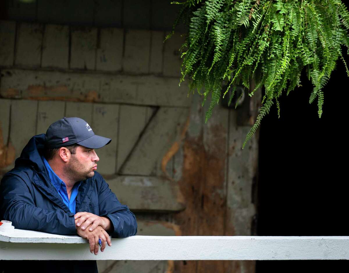 Trainer Brad Cox takes a moment to himself as he waits for 2021 Haskel winner Mandaloun to arrive from Monmouth Park in New Jersey at the Saratoga Race Course Sunday July 18, 2021 in Saratoga Springs, N.Y. Photo Special to the Times Union by Skip Dickstein