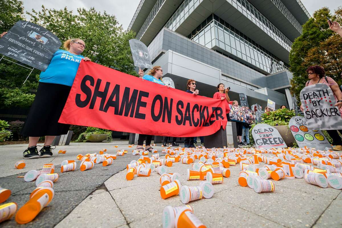 Members of P.A.I.N. (Prescription Addiction Intervention Now) and Truth Pharm stage a protest on Sept. 12, 2019 outside the Purdue Pharma headquarters at 201 Tresser Blvd., in downtown Stamford, Conn.