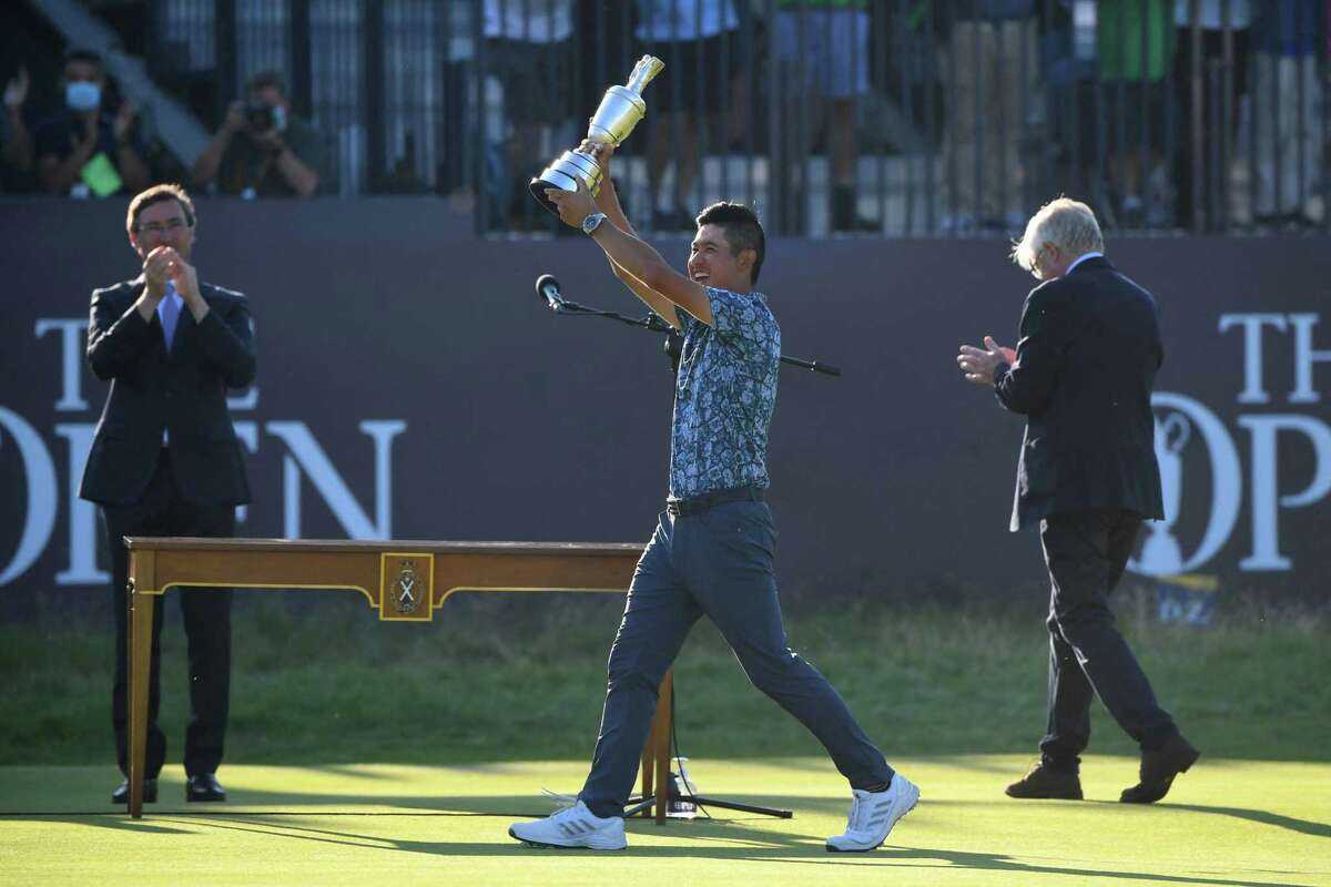 US golfer Collin Morikawa celebrates with the Claret Jug, the trophy for the Champion Golfer of the Year, after winning the 149th British Open Golf Championship at Royal St George's, Sandwich in south-east England on July 18, 2021. (Photo by ANDY BUCHANAN / AFP) / RESTRICTED TO EDITORIAL USE (Photo by ANDY BUCHANAN/AFP via Getty Images)