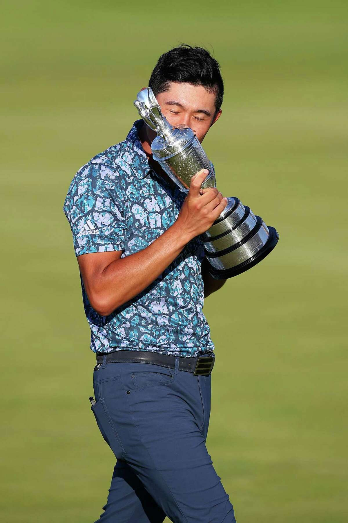 SANDWICH, ENGLAND - JULY 18: Open Champion, Collin Morikawa of United States celebrates with the Claret Jug on the 18th hole during Day Four of The 149th Open at Royal St George's Golf Club on July 18, 2021 in Sandwich, England. (Photo by Christopher Lee/Getty Images)