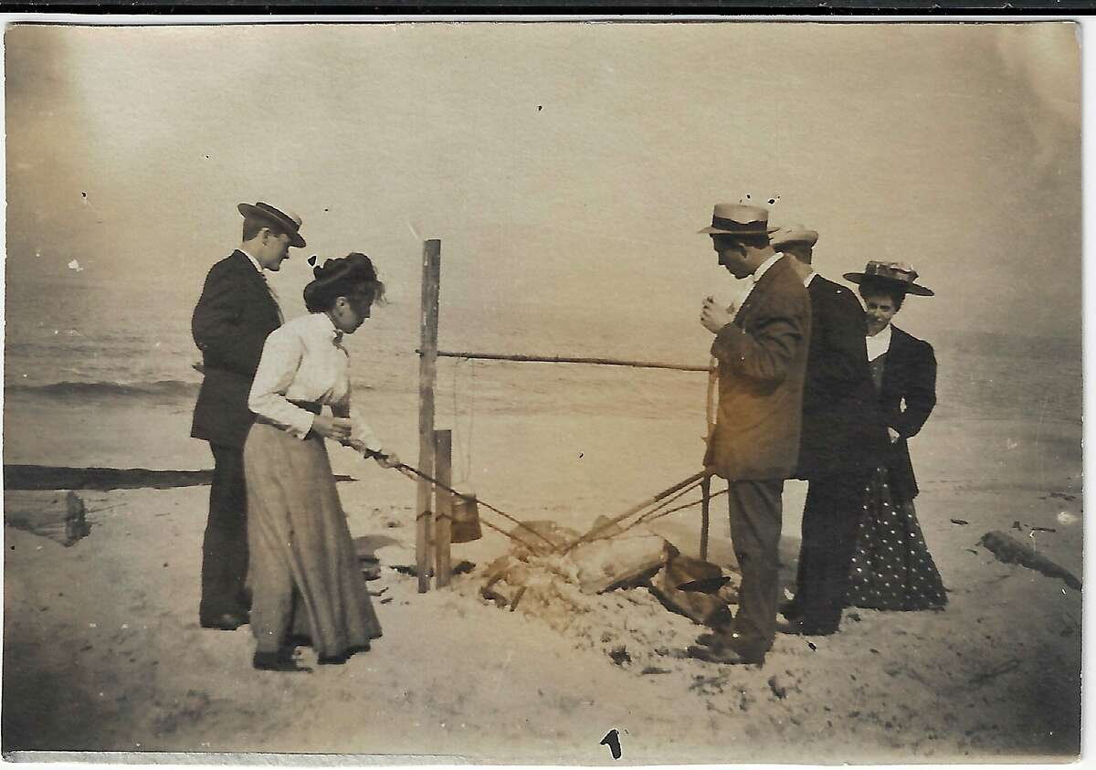 A group of people have a picnic at Frankfort beach in 1900.Identified are Harry Bannister, Jesse Brownson, Charlie Fairchild, Mabel Slaterand Lou Spencer. (Courtesy photo/Benzie Area Historical Museum)