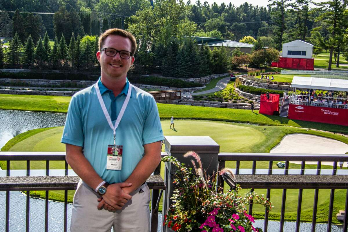 Sports writer Austin Chastain stands outside the clubhouse at Midland Country Club after the final round of the Dow Great Lakes Bay Invitational on July 17, 2021.