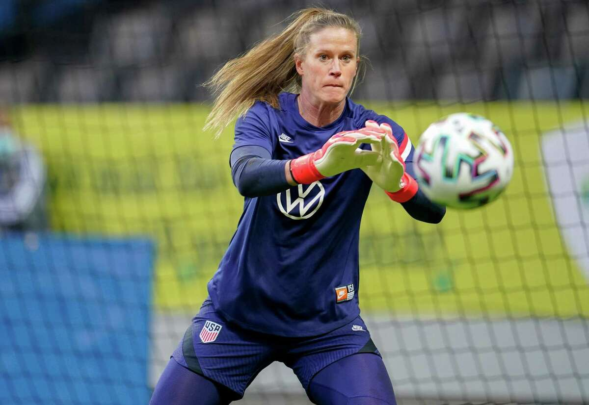 Alyssa Naeher, of the United States, warms up before a game.