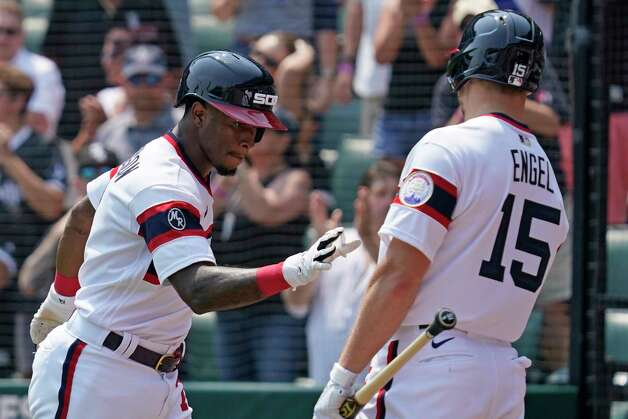 Chicago White Sox's Tim Anderson, left, celebrates with teammate Adam Engel after hitting a solo home run during the fifth inning of a baseball game against the Houston Astros in Chicago, Sunday, July 18, 2021. (AP Photo/Nam Y. Huh) Photo: Nam Y. Huh, Associated Press / Copyright 2021 The Associated Press. All rights reserved.