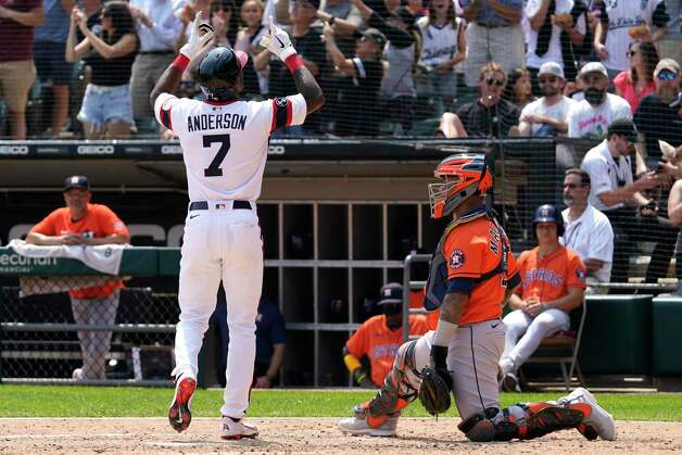 Chicago White Sox's Tim Anderson, left, celebrates after hitting a solo home run, next to Houston Astros catcher Martin Maldonado during the fifth inning of a baseball game in Chicago, Sunday, July 18, 2021. (AP Photo/Nam Y. Huh) Photo: Nam Y. Huh, Associated Press / Copyright 2021 The Associated Press. All rights reserved.