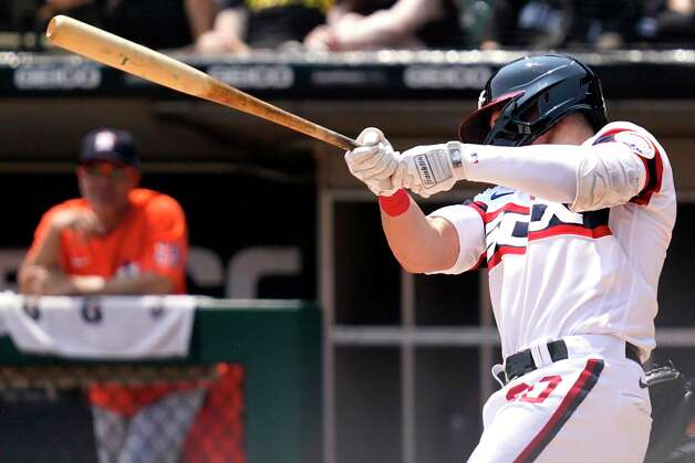 Chicago White Sox's Danny Mendick hits an RBI single during the second inning of the team's baseball game against the Houston Astros in Chicago, Sunday, July 18, 2021. (AP Photo/Nam Y. Huh) Photo: Nam Y. Huh, Associated Press / Copyright 2021 The Associated Press. All rights reserved.