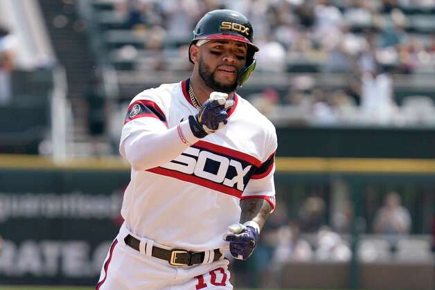 Chicago White Sox's Yoan Moncada rounds the bases after hitting a solo home run during the fourth inning of a baseball game against the Houston Astros in Chicago, Sunday, July 18, 2021. (AP Photo/Nam Y. Huh) Photo: Nam Y. Huh, Associated Press / Copyright 2021 The Associated Press. All rights reserved.
