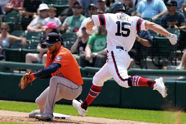 Chicago White Sox's Adam Engel, right, grounds out as Houston Astros first baseman Yuli Gurriel handles the throw during the third inning of a baseball game in Chicago, Sunday, July 18, 2021. (AP Photo/Nam Y. Huh) Photo: Nam Y. Huh, Associated Press / Copyright 2021 The Associated Press. All rights reserved.