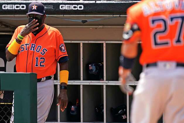 Houston Astros manager Dusty Baker Jr., left, signals during a Jose Altuve at-bat during the third inning of the team's baseball game against the Chicago White Sox in Chicago, Sunday, July 18, 2021. (AP Photo/Nam Y. Huh) Photo: Nam Y. Huh, Associated Press / Copyright 2021 The Associated Press. All rights reserved.
