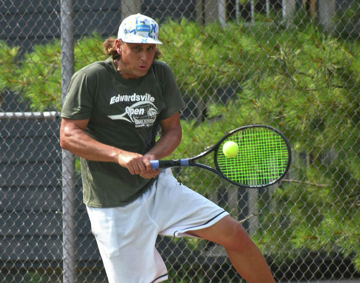 Brian Battistone connects for a shot during his doubles final match in the Doubles Shootout on Saturday at the EHS Tennis Center in Edwardsville.