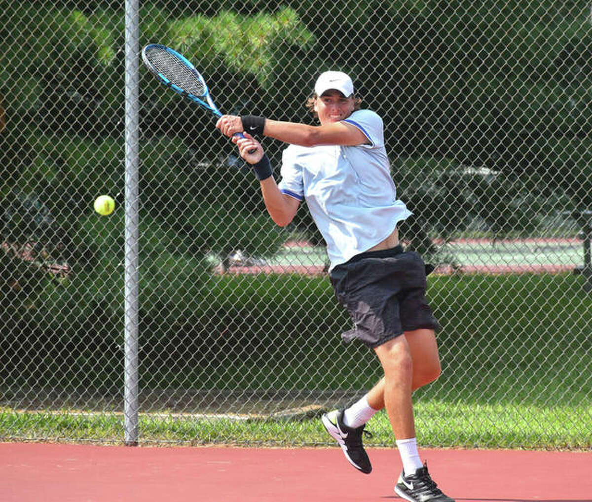 Jamie Vance hits a backhand shot during his doubles final match in the Doubles Shootout on Saturday at the EHS Tennis Center in Edwardsville.