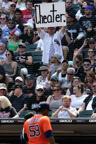 A Chicago White Sox fan holds a sign while Houston Astros starting pitcher Framber Valdez leaves the field during the seventh inning of the team's baseball game against the White Sox in Chicago, Sunday, July 18, 2021. (AP Photo/Nam Y. Huh) Photo: Nam Y. Huh, Associated Press / Copyright 2021 The Associated Press. All rights reserved.