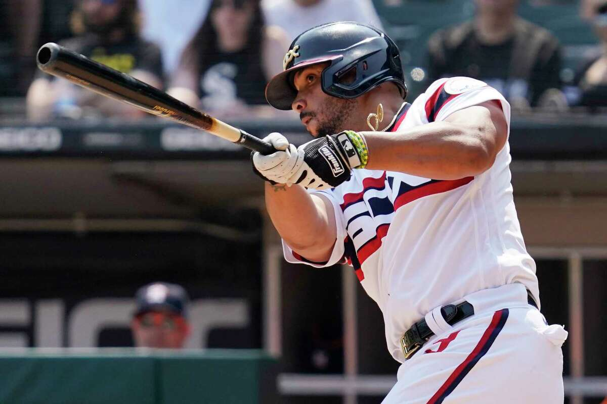 Chicago White Sox's Jose Abreu hits a double during the seventh inning of a baseball game against the Houston Astros in Chicago, Sunday, July 18, 2021. (AP Photo/Nam Y. Huh)