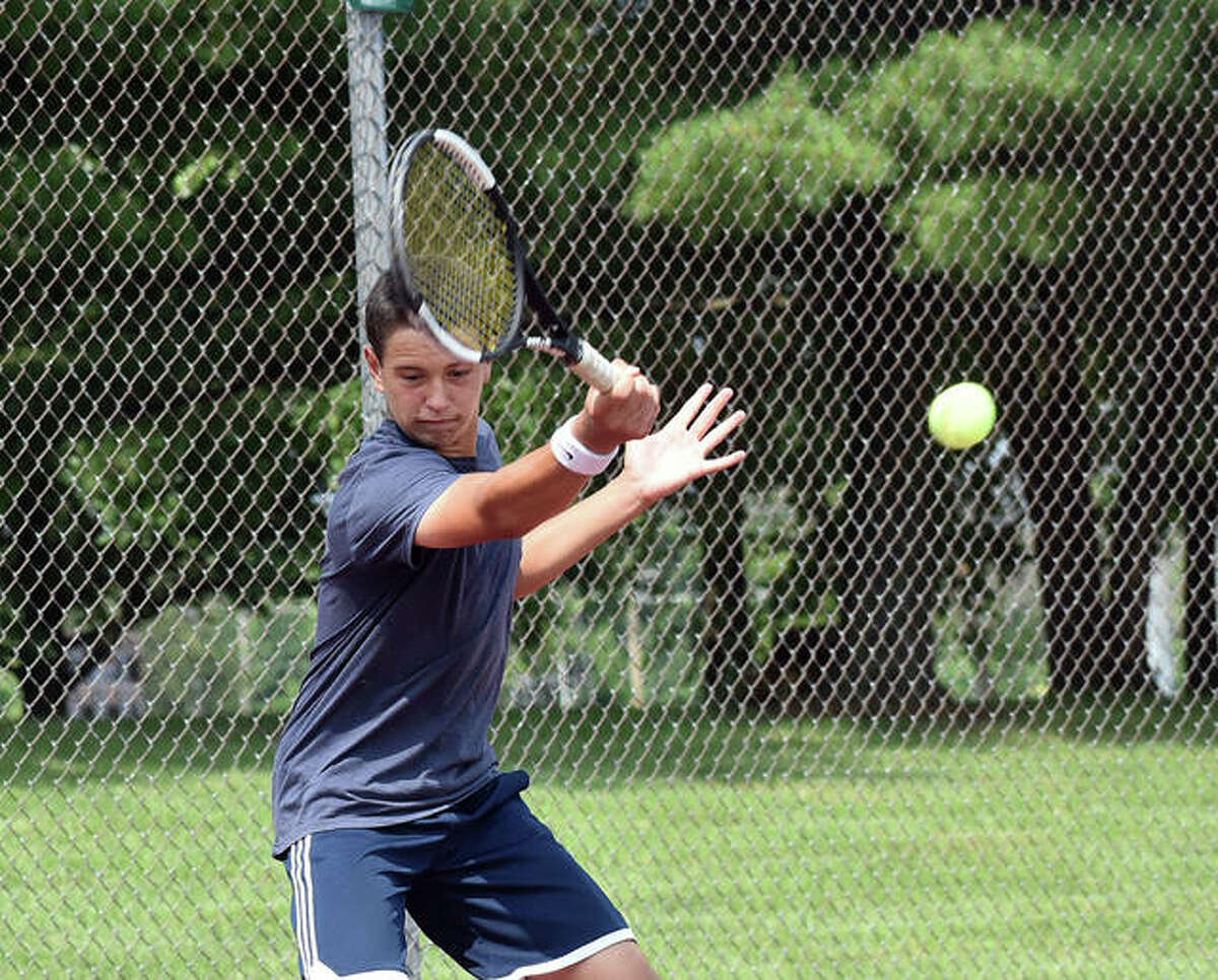 Jesse Hattrup connects for a shot during his match in the Doubles Shootout on Saturday at the EHS Tennis Center in Edwardsville.