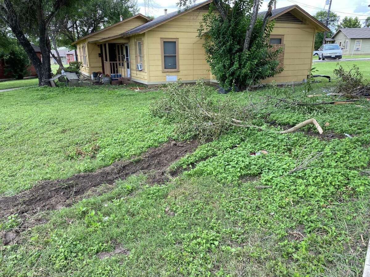 Multiple houses in the 3000 block of East Southcross Boulevard were damaged early Saturday when an SUV rolled off the road after hitting the curb.