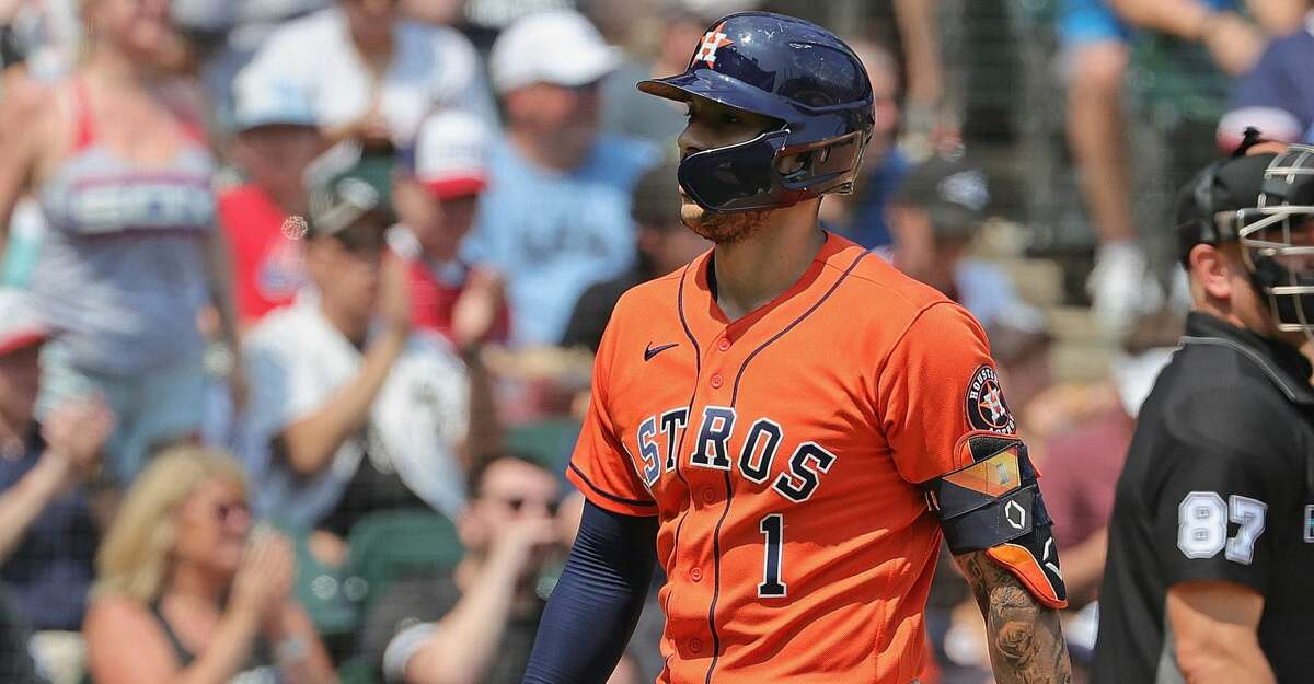 CHICAGO, ILLINOIS - JULY 18: Carlos Correa #1 of the Houston Astros walks to the dugout after striking out in the 5th inning against the Chicago White Sox at Guaranteed Rate Field on July 18, 2021 in Chicago, Illinois. (Photo by Jonathan Daniel/Getty Images)