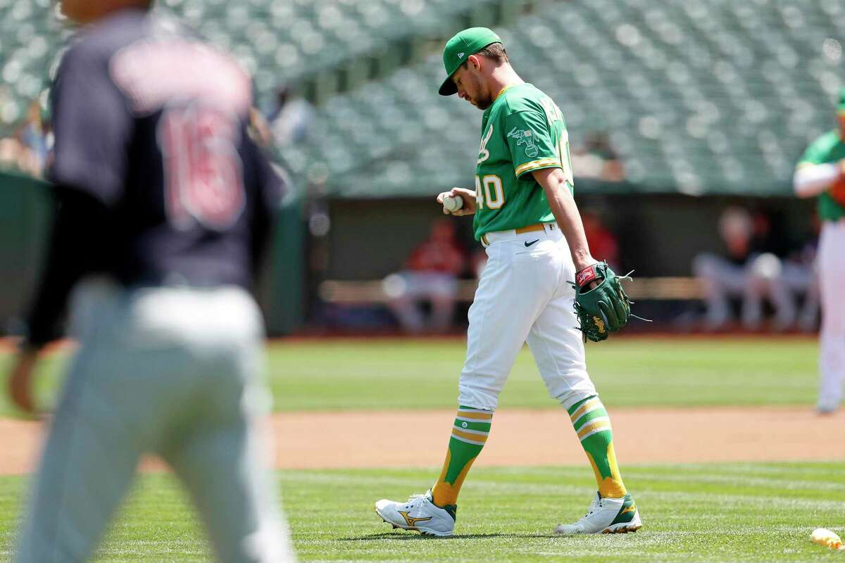Oakland Athletics' starting pitcher Chris Bassitt reacts to giving up first pitch home run in 1st inning to Cleveland Indians' Bradley Zimmer during MLB game at Oakland Coliseum in Oakland, Calif., on Sunday, July 18, 2021.
