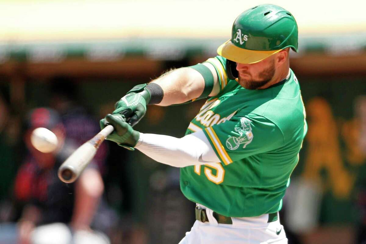 Oakland Athletics' Seth Brown hits a game-tying solo home run in 5th inning against Cleveland Indians during MLB game at Oakland Coliseum in Oakland, Calif., on Sunday, July 18, 2021.