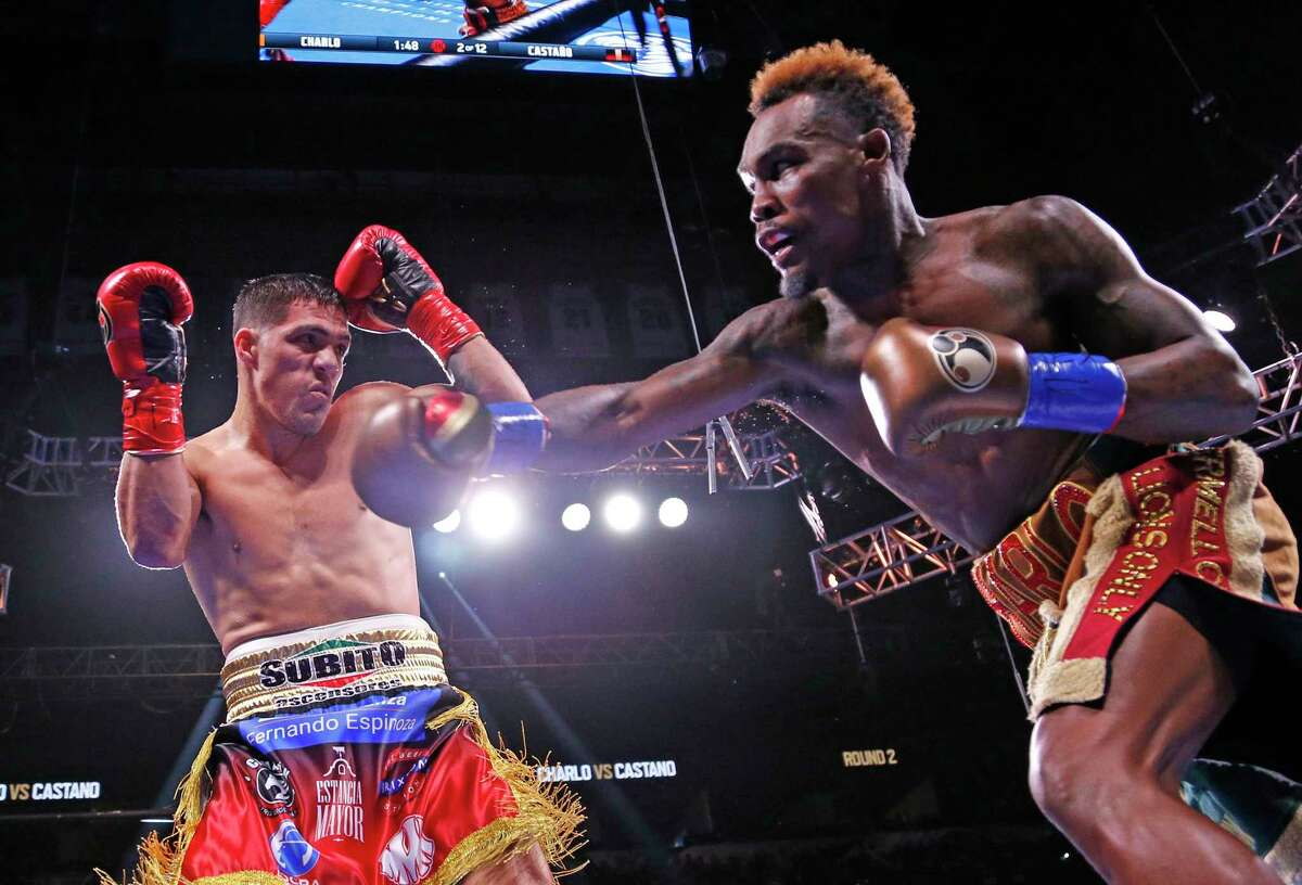 Jermell Charlo,R, throws a right at Brian Castano in their undisputed championship at 154 pounds in a Premier Boxing Champions on Saturday, July 17, 2021 at the AT&T Center. The fight was a draw.