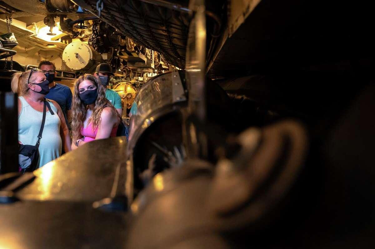 Tara, Steve, Jillian and Josh Ostaszewicz tour the torpedo bay below deck of the World War II submarine Pampanito. The guns on the boat were restored as part of the refurbishment.