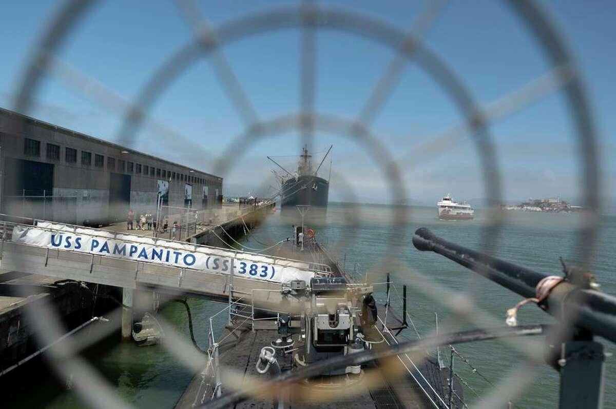Tourists visit the World War II submarine Pampanito at Pier 45.