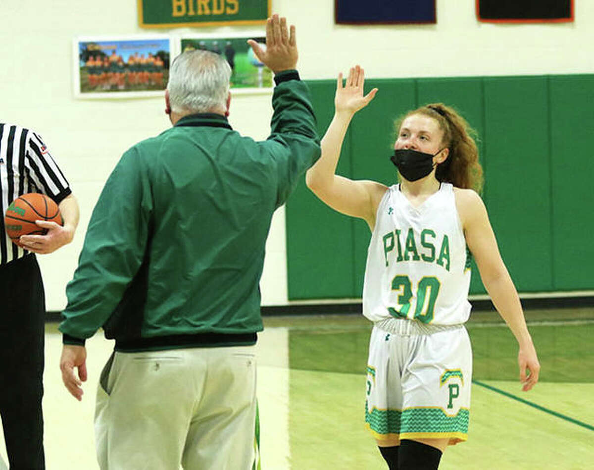 Southwestern coach Steve Wooley congratulates Rylee Smith as she leaves the court at her final home game for the Piasa Birds in a SCC title-clinching win over Pana on March 6.