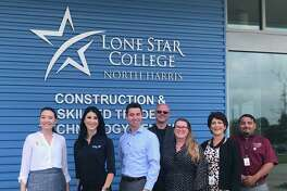 This fall semester, Johnson Controls will be giving Lone star College $100,000 to help students studying skilled trades and technical training with financial needs graduate. Nicole Robinson Gauthier, left, CFRE, LSC Foundation executive director; Candice Ann Palacios, JCI Lead Systems specialist II; Britt Willows, JCI Houston general manager; William Pepperman, JCI senior technician; Charis Prejean, LSC grants developer; Beth Thompson, LSC Resource Development executive director and Osvaldo Caballero, LSC Construction Technologies director.