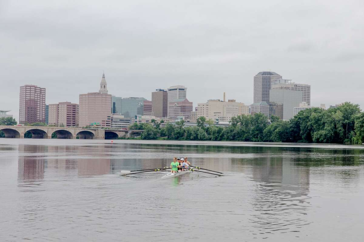 A rowing class moves towards downtown Hartford.