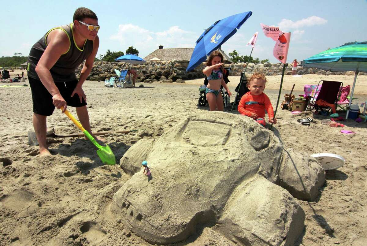 The Sand Blast sand sculpture competition is held at Greenwich Point Park in Greenwich, Conn., on Saturday July 17, 2021. The sculptures ranged from the traditional sand castles to giant sea stars. One inventive family even made boats - that didn't go anywhere - and another group sculpted a giant turtle. The annual contest returned this year after it was canceled last year during the COVID-19 pandemic.
